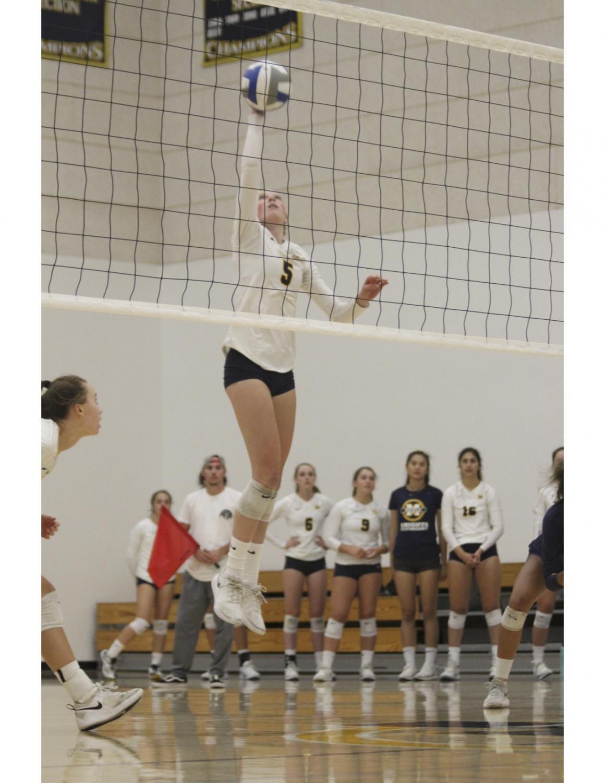 Senior Grace King hits the ball.