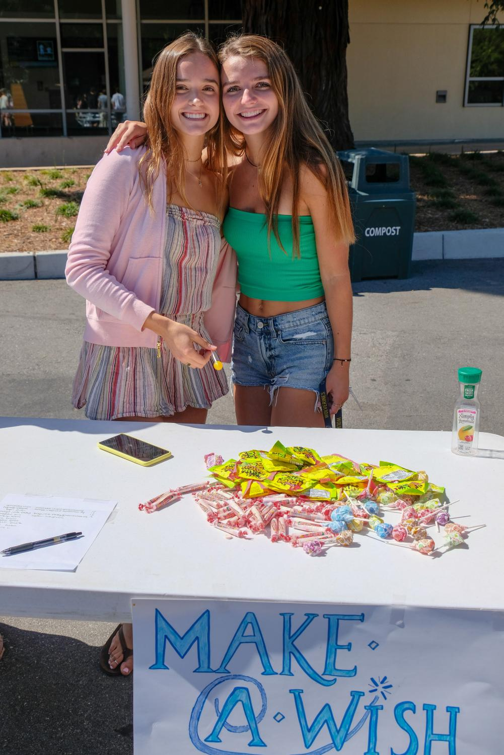Abby Doll and Alex McCusker pose for a picture at the Clubs Fair. Staff Photo: Caroline Frantz.