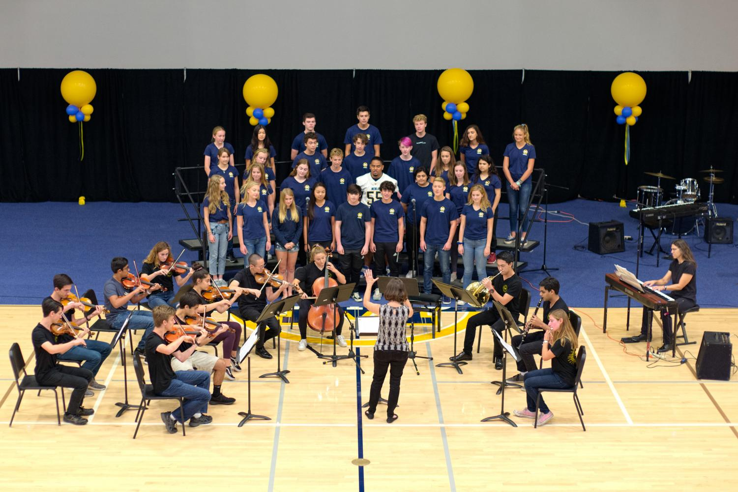 "Upper School students perform ""A Million Dreams""     at last week's assembly. Photo courtesy of Cyrus Lowe on Flickr."