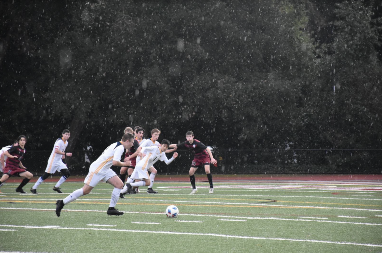 Senior Connor Nelson takes the ball down the field. Photo courtesy of Sadie Stinson.