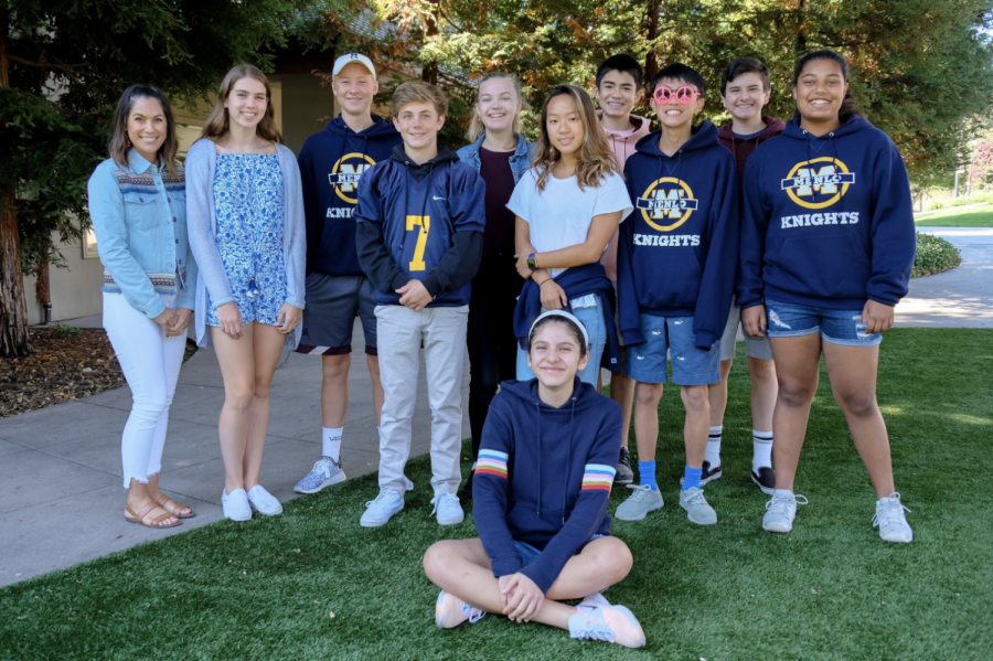 """Lisa Giarratano and her freshman advocacy group who are already developing a strong sense of trust with each other. """"By the time they're seniors, I think we'll know way too much about each other, which is fine!"""" Giarratano said. Photo courtesy of Pete Zivkov."""