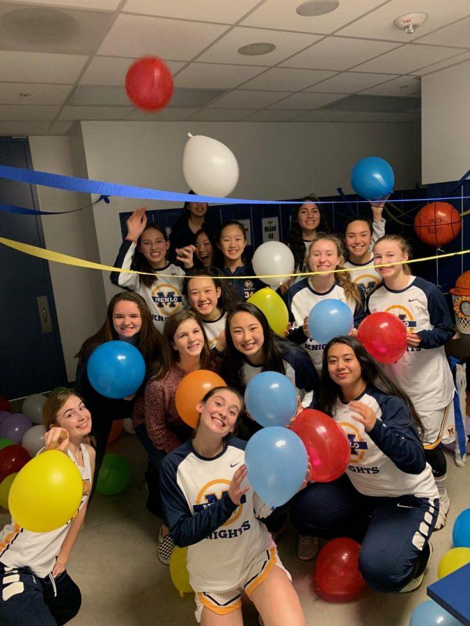 Girls+basketball+celebrates+senior+Sun-Mi+Oh+in+the+locker+room.+Photo+courtesy+of%3A+Bella+Stuart.