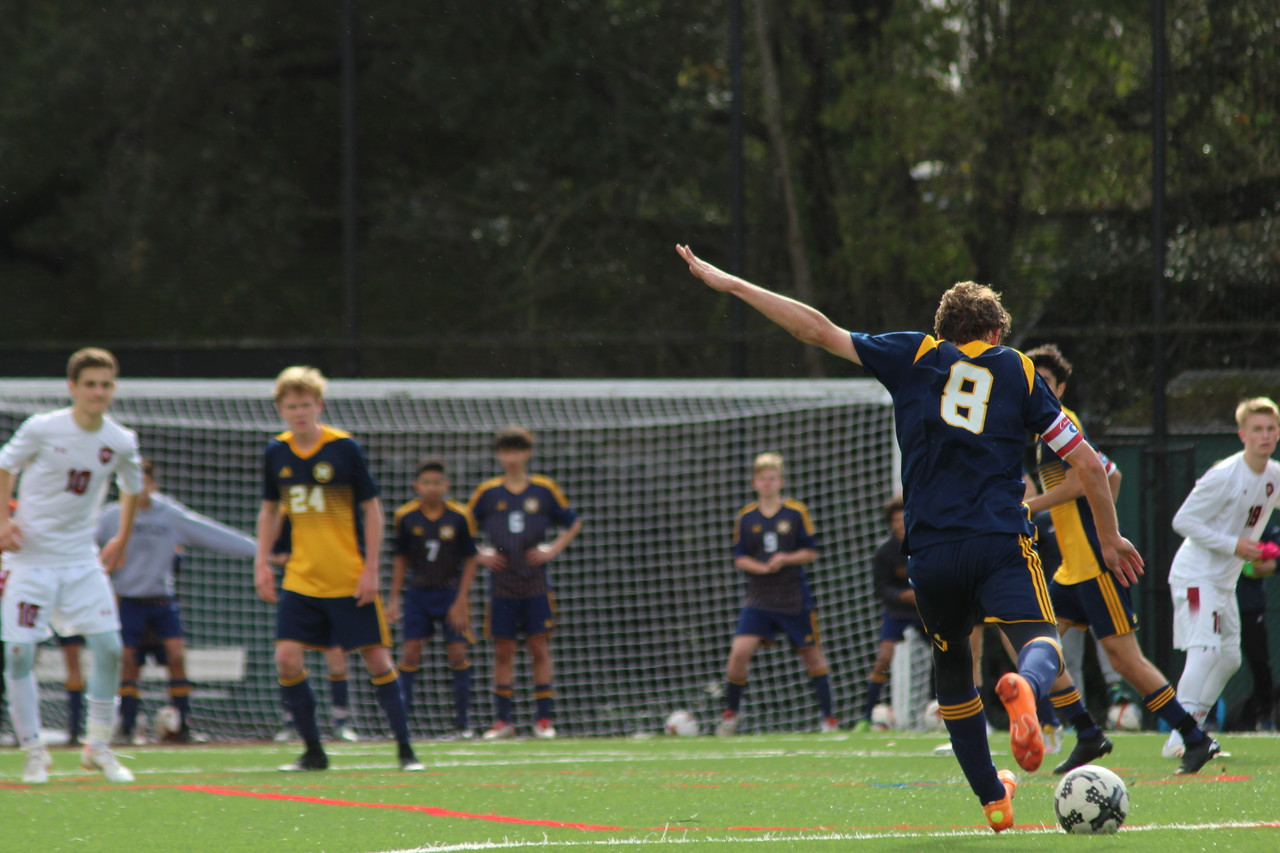 Senior Ben Lasky takes the ball up the field. Staff Photo: Bella Scola.