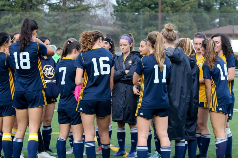 The+varsity+girls+soccer+team+during+a+huddle+on+the+field.+Photo+courtesy+of+Pam+Tso+McKenny.