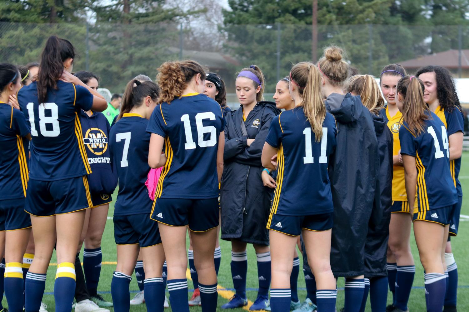 The varsity girls soccer team during a huddle on the field. Photo courtesy of Pam Tso McKenny.