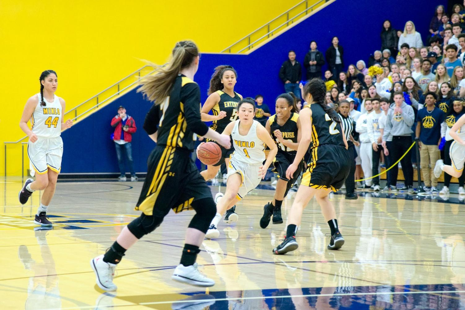 Sophomore Avery Lee drives to the basket. Photo courtesy of Cyrus Lowe.