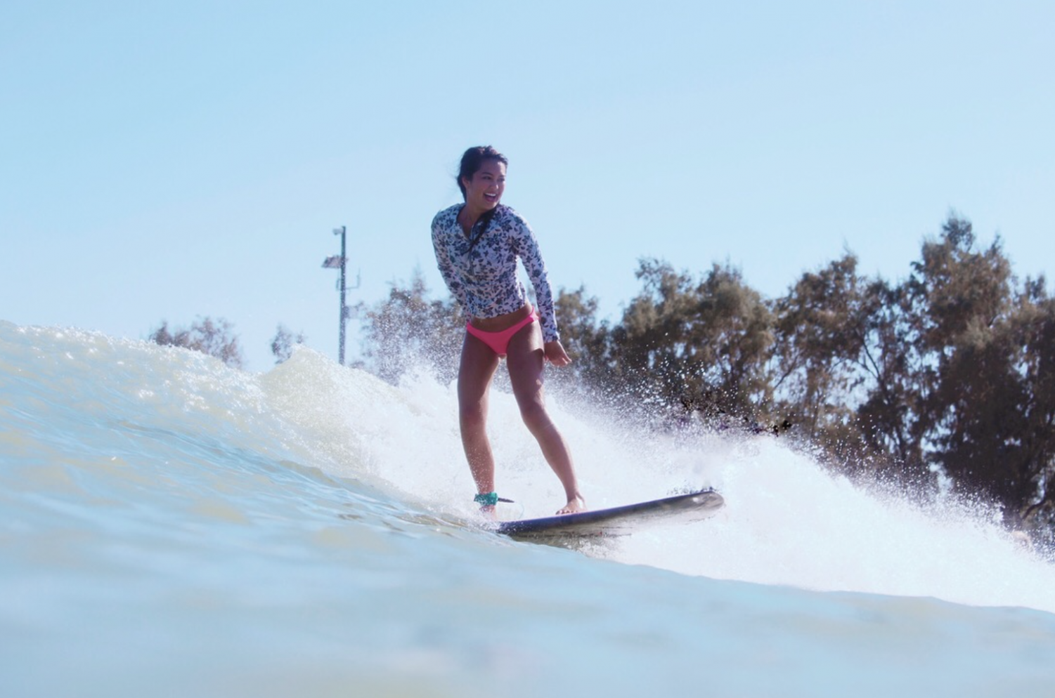 Izzy Banatao catches a wave at Kelly Slater's Surf Ranch in Lemoore California. The Surf Ranch allows for people to surf on man-made waves, 100 miles away from the ocean. Photo courtesy of Izzy Banatao.