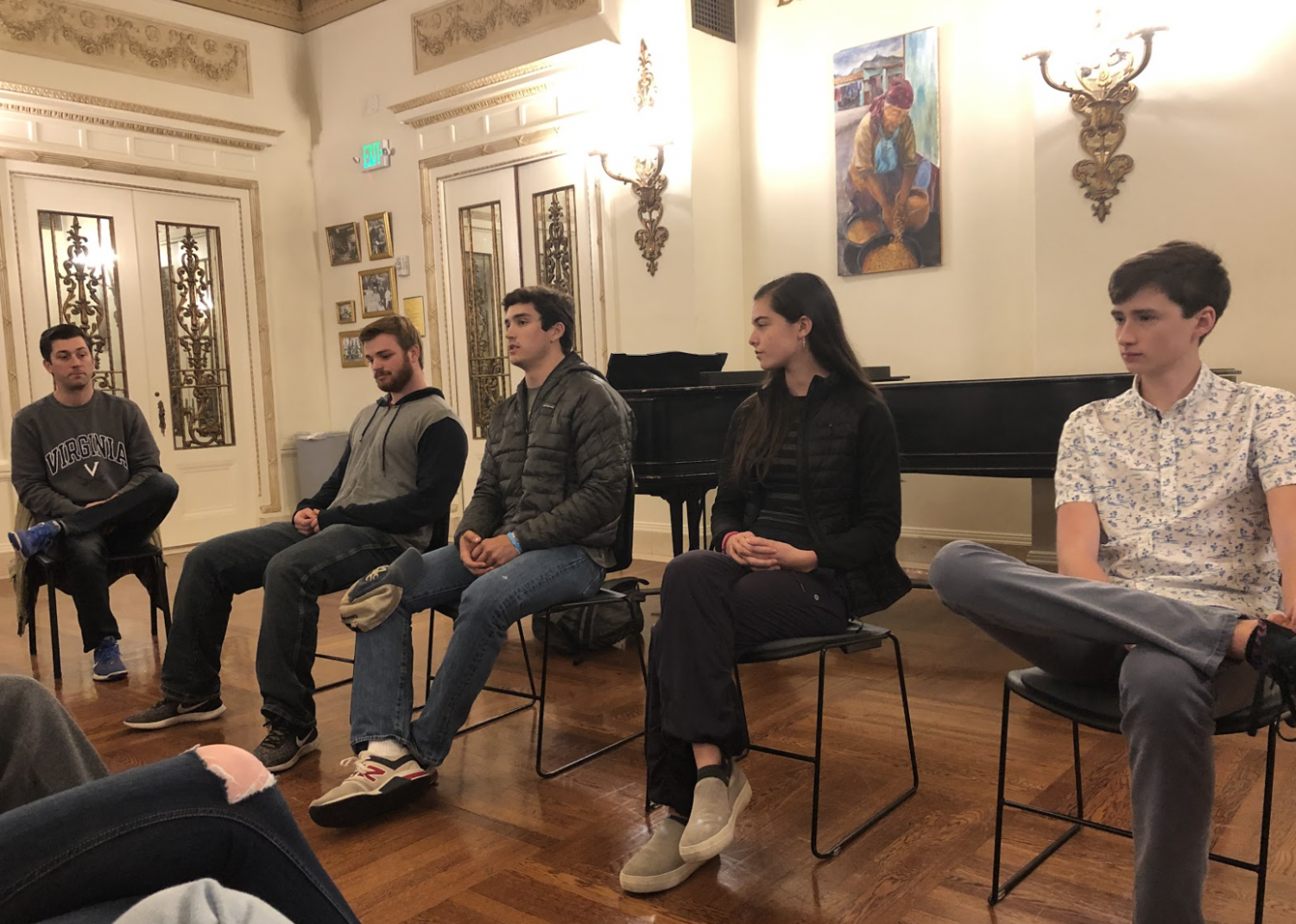 Seniors Brian Mhatre, Connor McCusker, and Jake Martin and junior Charlotte Acra speak about their beliefs and experiences at Menlo during the diversity of thought panel discussion. Staff photo: Samantha Stevens.