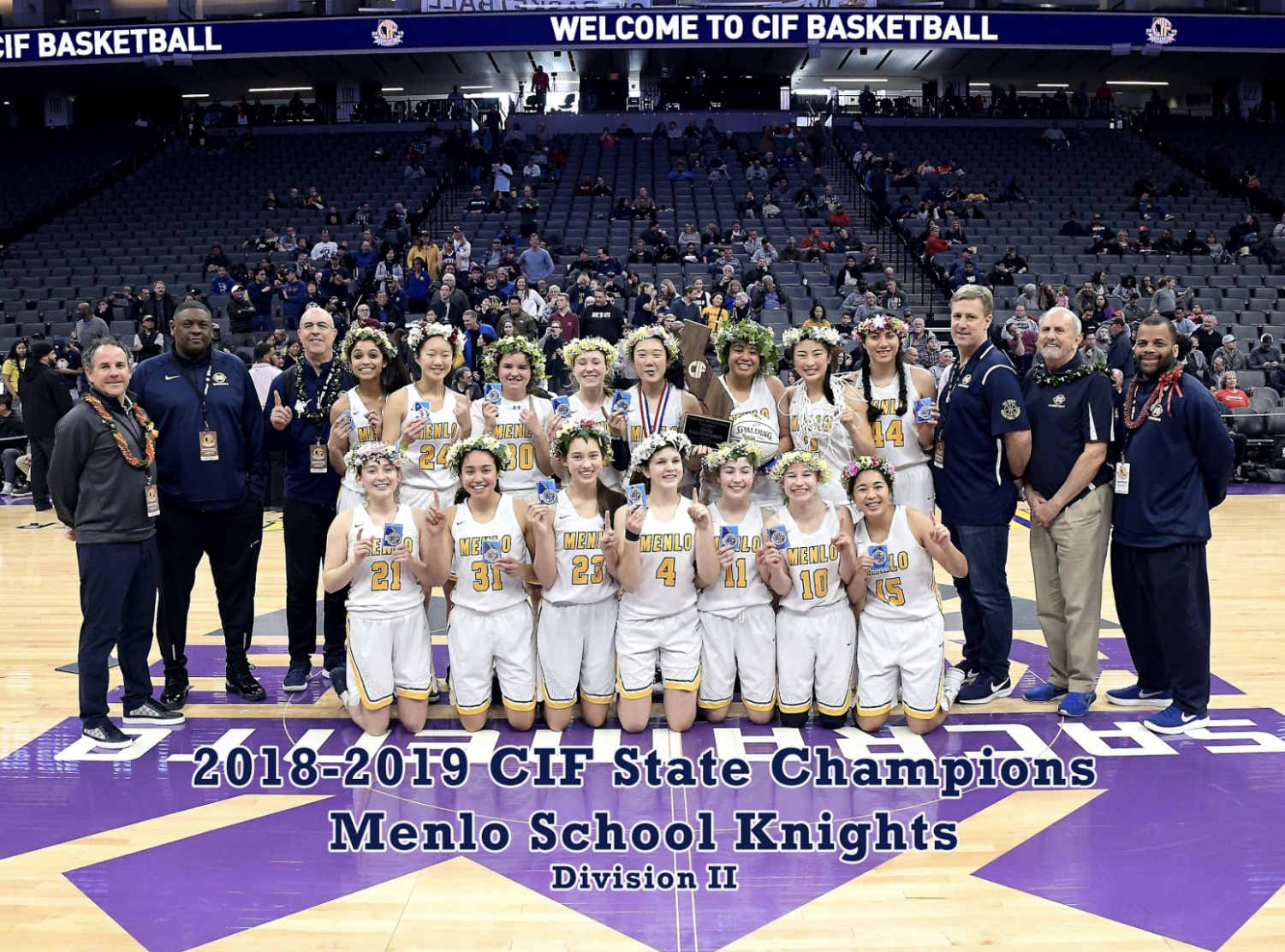 The varsity girls basketball team and coaches pose for a picture as the new Division II CIF State Champions. Photo courtesy of Danielle McNair via MaxPreps.