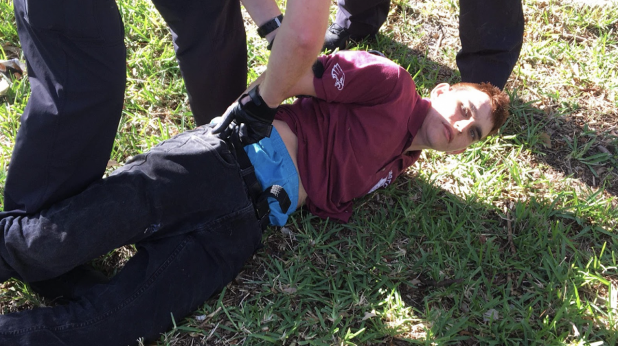 A Coconut Creek Police officer identifies a suspect that is wearing the same clothes as the shooter. A witness who saw PS arrive at the school before the shooting confirmed that it was him on the scene, and PS is arrested. Photo from Wikimedia Commons.