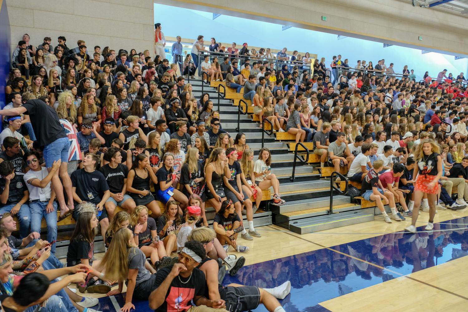 Seniors and juniors engage in welcome-back assembly led by spirit coordinator Emma Dressel. Creative Commons Photo: Menlo School on Flickr.