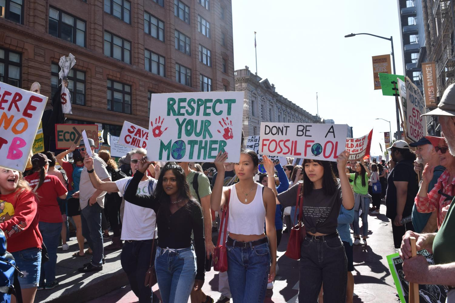 Youth march down 7th Street with signs. Staff Photo: Kate Hammond.