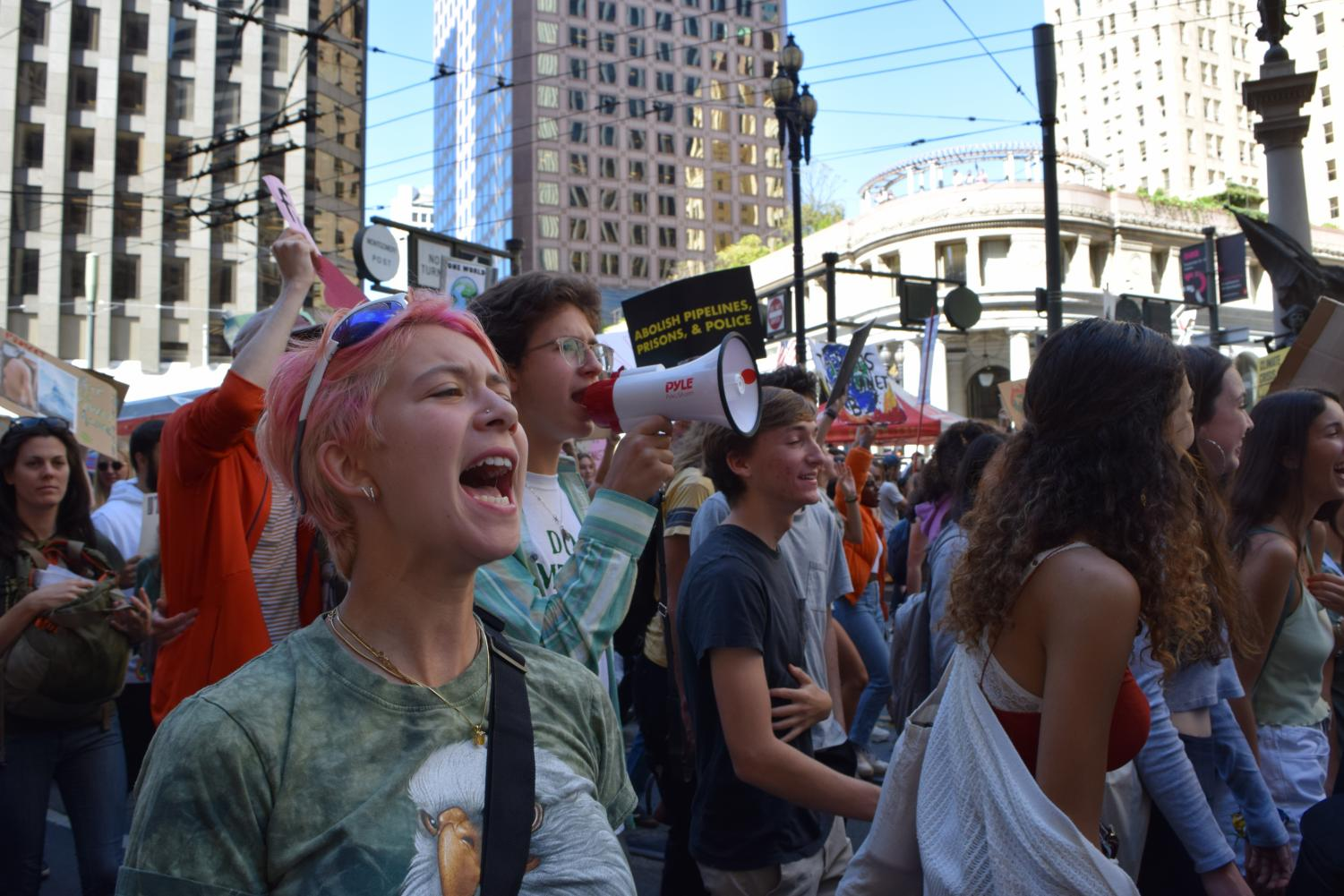 Protesters chant while marching on Market Street. Staff Photo: Kate Hammond.