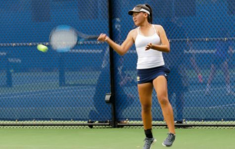 Sophomore Tricia Zhang hits a forehand in the Tyler Nii Memorial Tournament. Staff Photo: Bella Guel.
