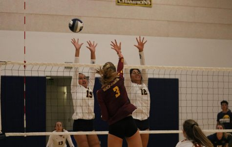 Freshman Havannah Hoeft and sophomore Sharon Nejad attempt to block a kill from M-A senior Natalie Grover. Photo Courtesy of Lucas Vogel.