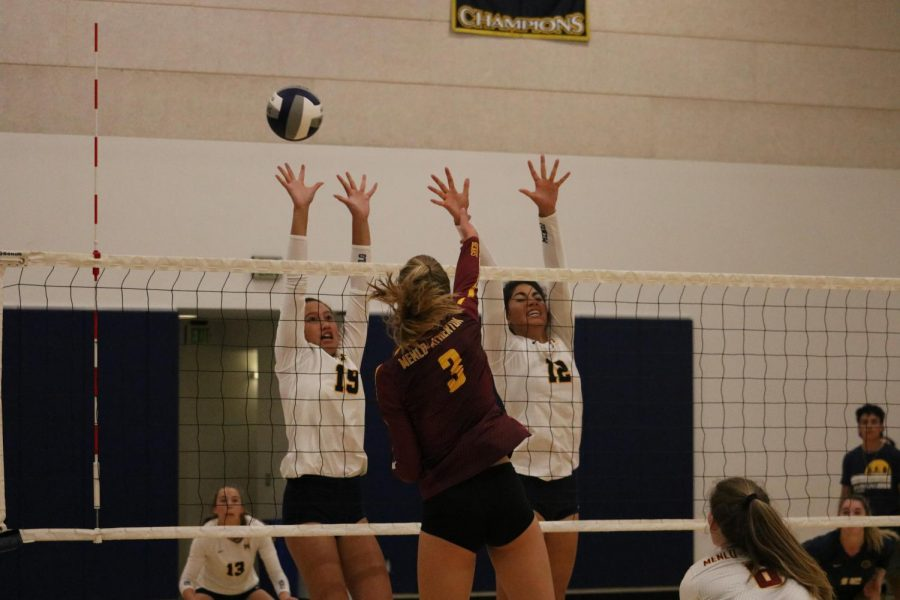 Freshman+Havannah+Hoeft+and+sophomore+Sharon+Nejad+attempt+to+block+a+kill+from+M-A+senior+Natalie+Grover.+Photo+Courtesy+of+Lucas+Vogel.+%0A