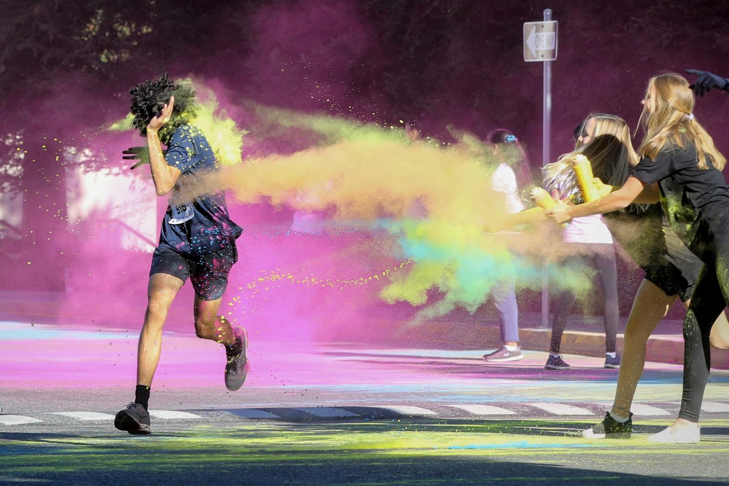 Runner gets sprayed with color as he finishes the race. Photo Courtesy of Leon Yao.