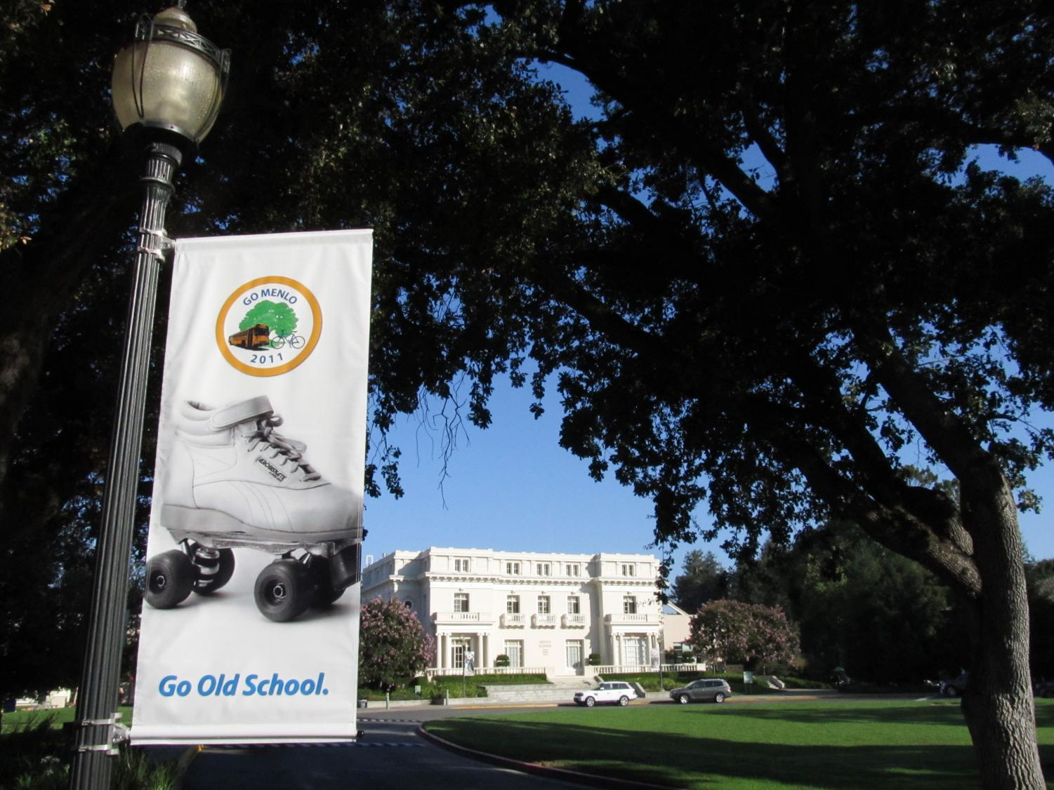 A poster hangs at the entrance to Menlo School in 2011, promoting the then-newly-founded GO MENLO program. GO MENLO promotes ways to reduce the number of drivers on Menlo's campus, such as roller skating or taking the bus. Photo courtesy of Pete Zivkov.