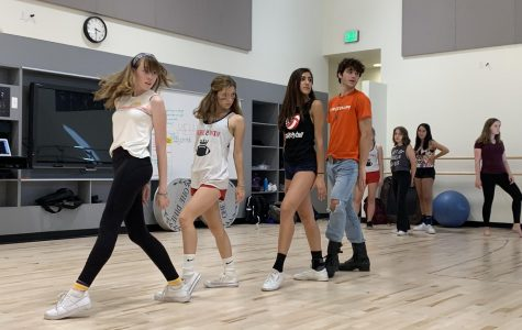 Juniors Langley Ward and Annabelle Marenghi, sophomore Uma Misha and Senior Declan Stanton practicing one of their dance numbers at rehearsal. Ward, Marenghi and Misha are cast as Kit Kat Girls and Stanton is the MC. Photo courtesy of Sammie Dostart-Meers.