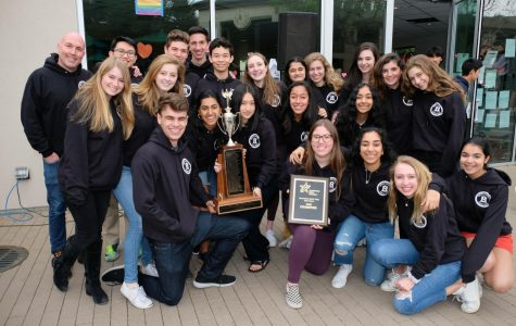 The varsity Mock Trial team with their trophies after winning the 2019 State Championship. Photo courtesy of Pete Zivkov.