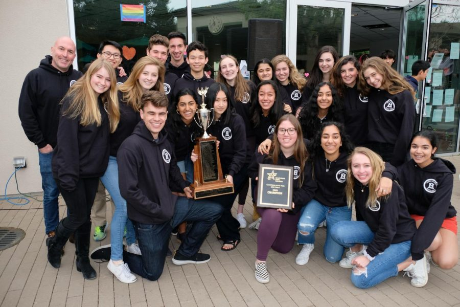 The+varsity+Mock+Trial+team+with+their+trophies+after+winning+the+2019+State+Championship.+Photo+courtesy+of+Pete+Zivkov.+%0A