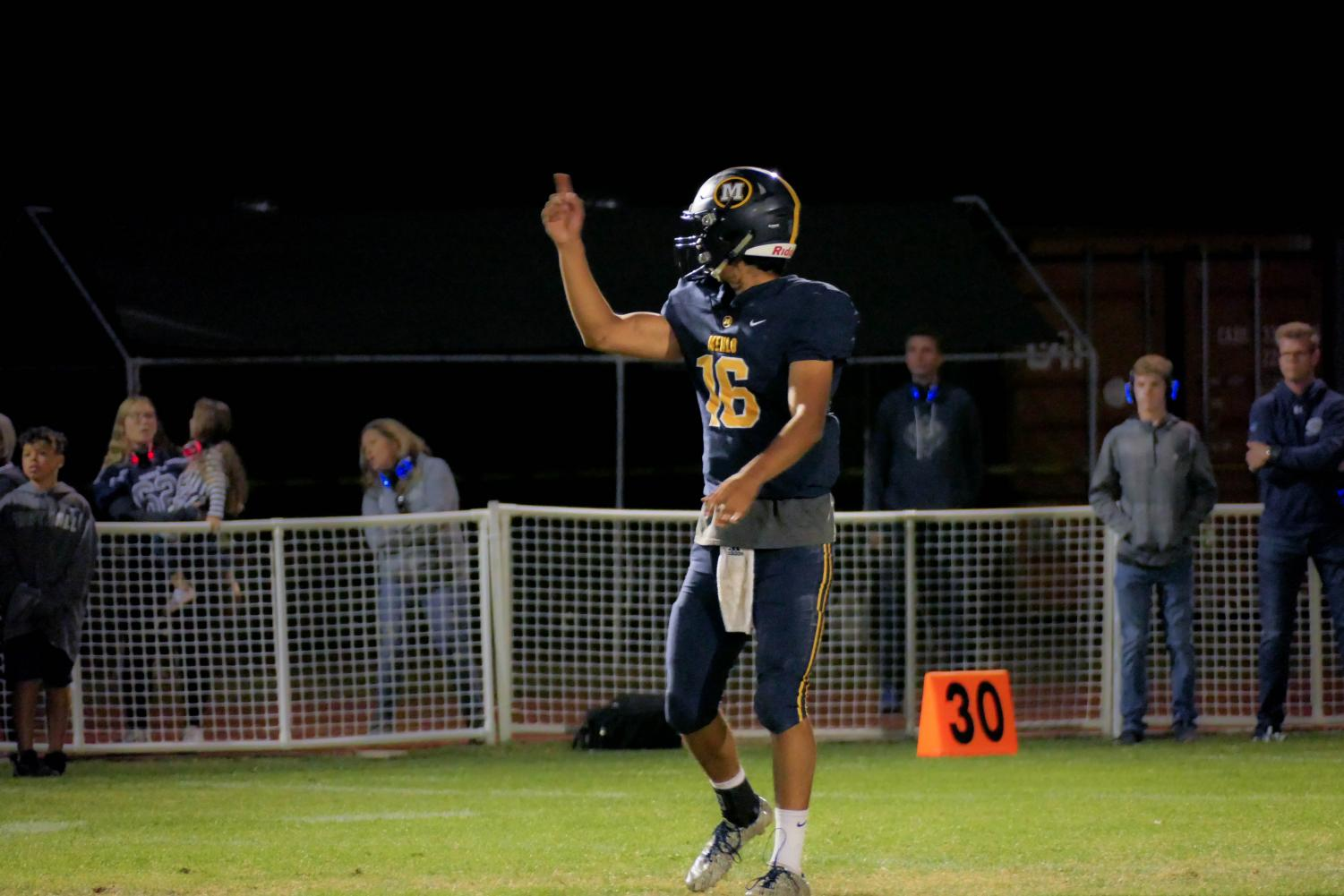 Senior quarterback Kevin Alarcon celebrates another first down and pushes his team to keep up the momentum. Staff Photo: Bella Guel.