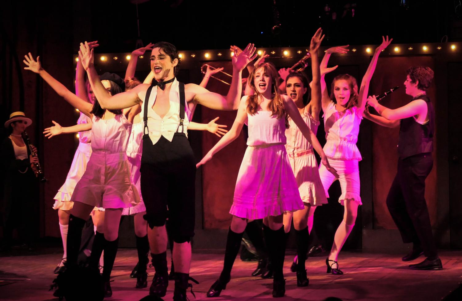 """The Emcee, played by senior Declan Stanton, and the Kit Kat girls perform the opening number """"Willkommen."""" Staff Photo: Bella Guel."""
