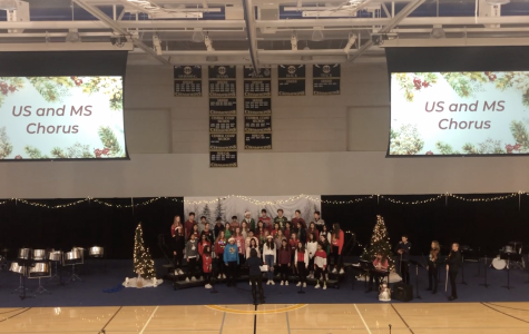 Middle and Upper school chorus come together to sing during the assembly. Staff Photo: Emily Han.