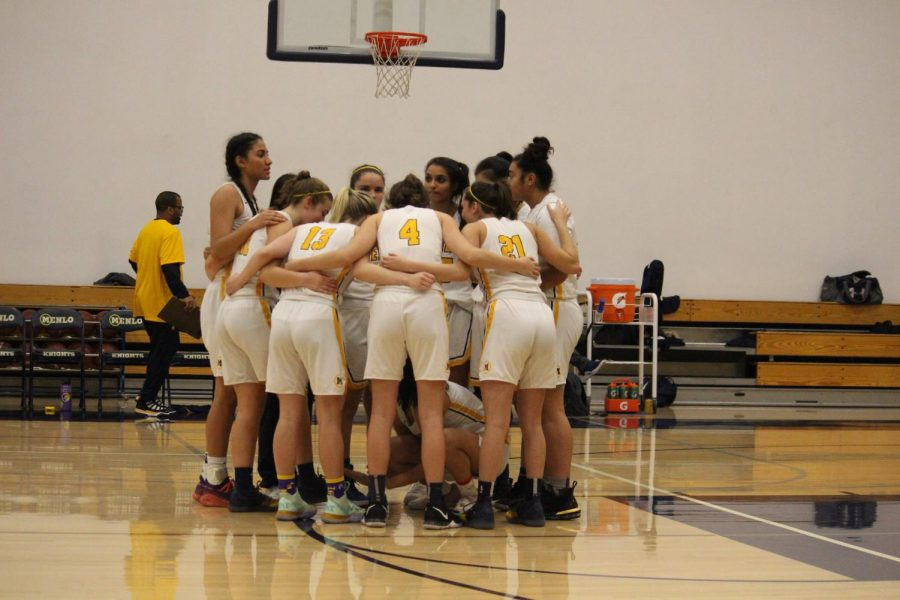 Players huddle during game against Pinewood. Photo Courtesy of Tate Lee.