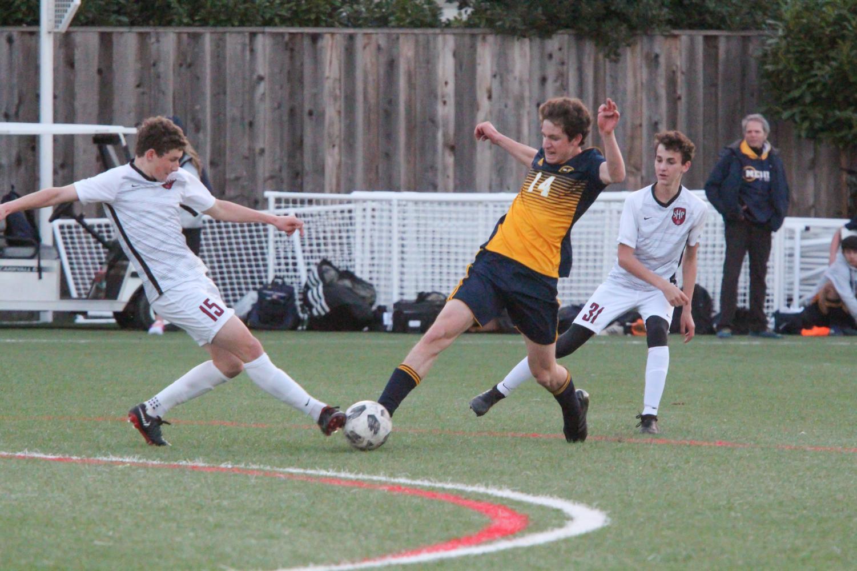 Junior Ilan Listgarten reaches to block a pass from opponent on SHP. Staff Photo: Sadie Stinson.