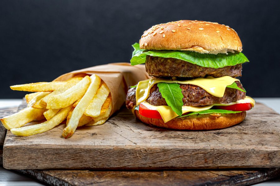 Producing one hamburger takes the same amount of fossil fuels as driving a small car for 20 miles. Creative Commons Photo: Wuestenigel on Flickr.