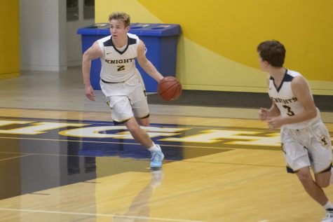 Senior Justin Sellers dribbles down the court. Photo courtesy of Doug Peck.
