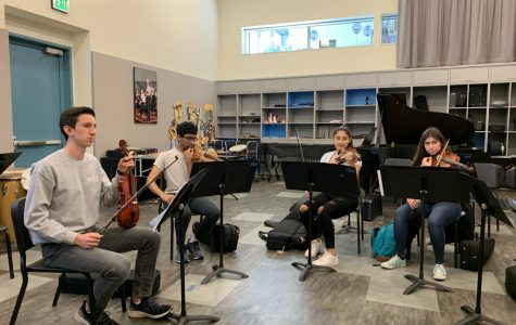 Orchestra practices for Creative Arts Week. Staff Photo: Carly McAdam.