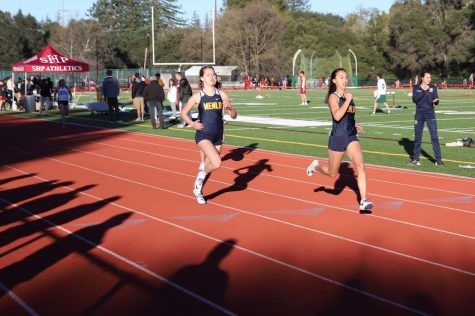 Menlo track team runners Lauren Hamilton and Michelle Louie finish their race in the 2019 WBAL meet at Sacred Heart. Photo Courtesy of  Robert Tomkinson.