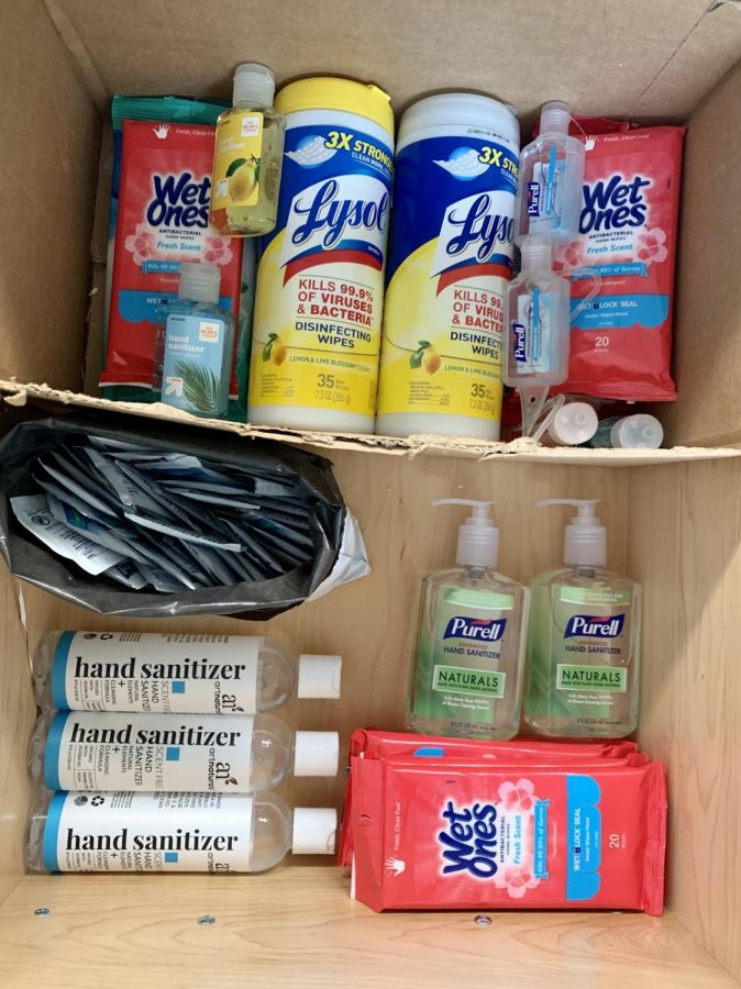 Families+collect+hand+sanitizer%2C+disinfecting+wipes+and+cleaning+supplies+in+attempts+to+prevent+the+spread+of+COVID-19.+Staff+Photo%3A+Louisa+Sonsini.+