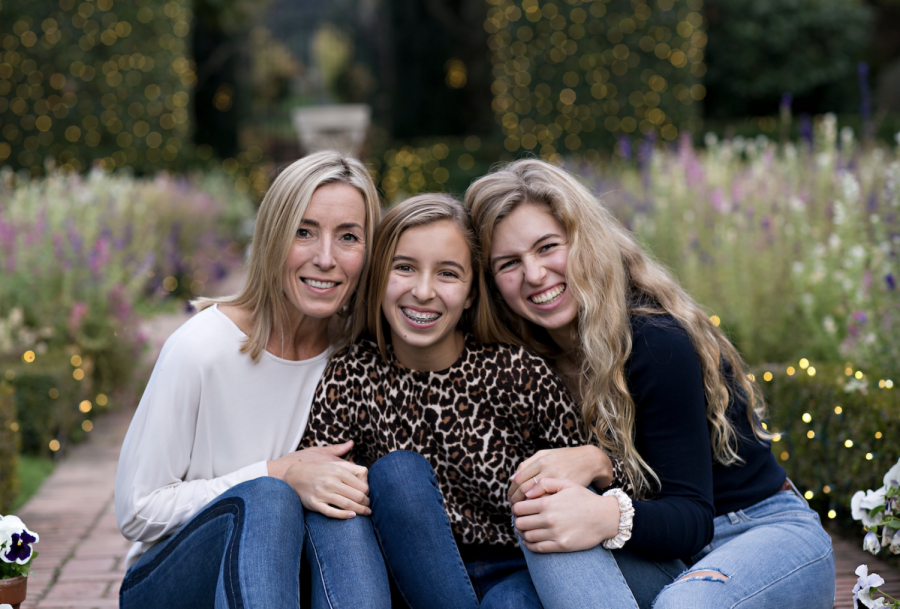 Freshman Alea Marks and junior Ella Marks pose with their mother, Laurel Marks, for a portrait. Photo courtesy of Ella Marks.