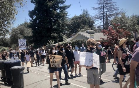 Protesters in Los Altos march on June 5 to show support for the intensifying demand to end systemic racism and police brutality in the United States. June 5 would have been the 27th birthday of Breonna Taylor, an innocent black woman shot and killed by police in her home. Staff photo: Emily Han.
