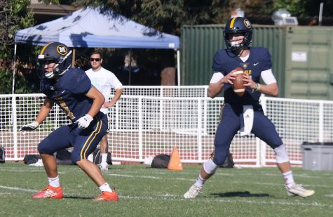 The football team plays in a game during the 2019 season, before the COVID-19 pandemic forced athletics to temporarily shut down. Some Menlo sports teams have now started reopening with new social distancing measures in place. Photo courtesy of Pam Tso McKenney.