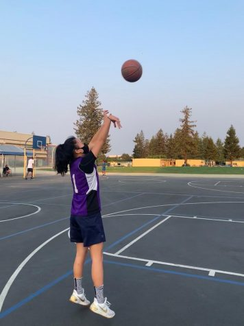 Senior Avery Lee shoots a basketball during a practice with her club. Lee said that after the pandemic, practicing basketball safely and comfortably has become more difficult. Photo courtesy of Avery Lee.