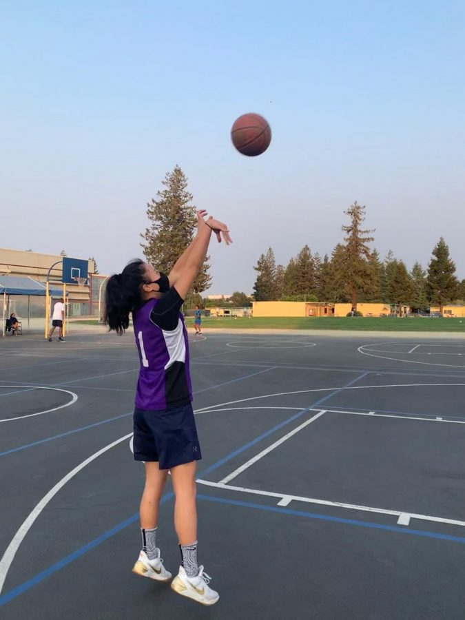 Senior+Avery+Lee+shoots+a+basketball+during+a+practice+with+her+club.+Lee+said+that+after+the+pandemic%2C+practicing+basketball+safely+and+comfortably+has+become+more+difficult.+Photo+courtesy+of+Avery+Lee.