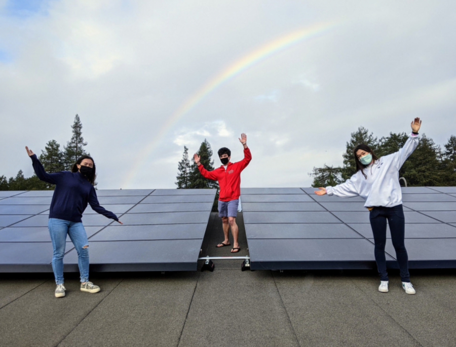 Senior members of Menlo's Climate Coalition, Gabby Kogler, Colin Skinner and Alix Borton, take a tour of the newly installed Tesla solar panels located on roof of the Athletic Center. Photo courtesy of Pete Zivkov.