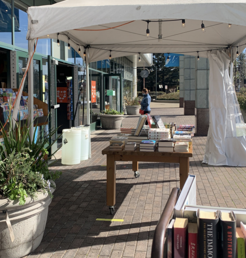 Books sit outside open windows and doors of Kepler's Books as a form of health safety measures. Restaurants and other businesses in downtown Menlo Park have had to rethink their normal business models amid the pandemic. Staff photo: Carly McAdam.