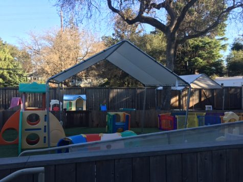 "Children in the Menlo daycare program are not permitted to leave their fenced-in yard and interact with their parents and others on campus as they used to. ""They"
