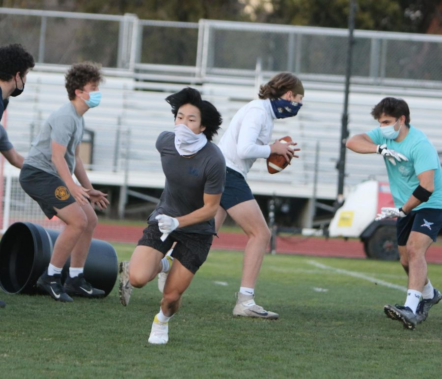 Menlo's varsity football team began practice in January with masks on and no helmets or pads, before receiving equipment in later February. Photo courtesy of Pam Tso McKenney.