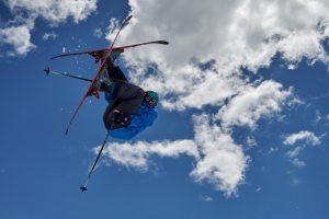 "Junior Max Saito flies through the air on his skis. ""I go pretty big; I've jumped off 50 foot cliffs."" Photo courtesy of Max Saito."