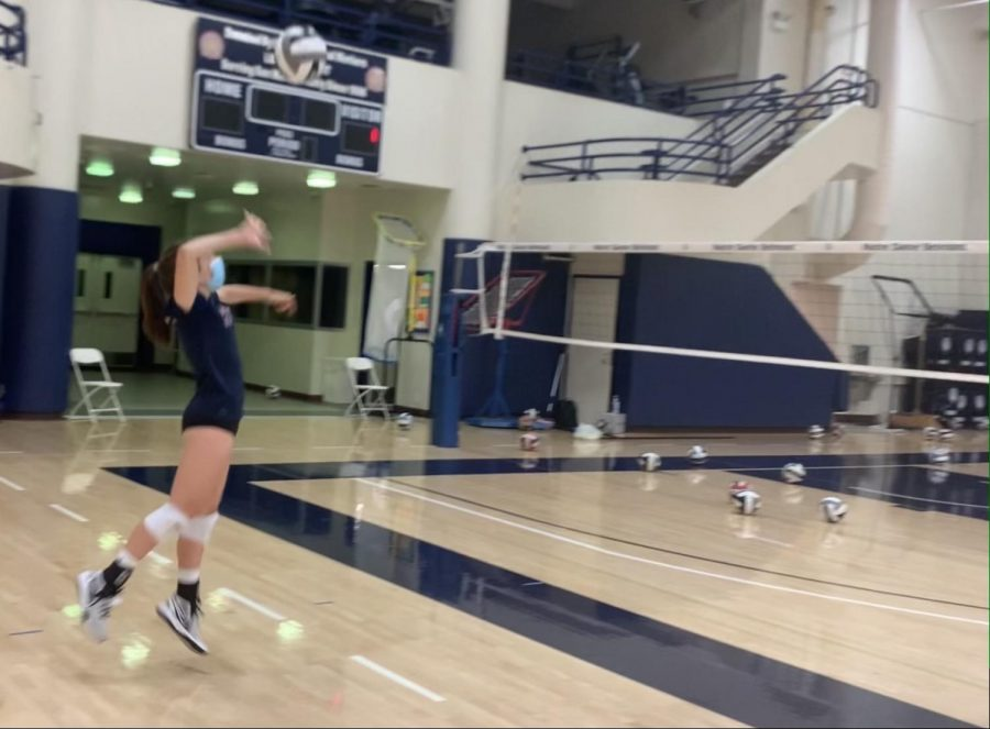Freshman Stella Buch practices volleyball with social distancing measures in place due to COVID-19. Photo courtesy of Stella Buch.