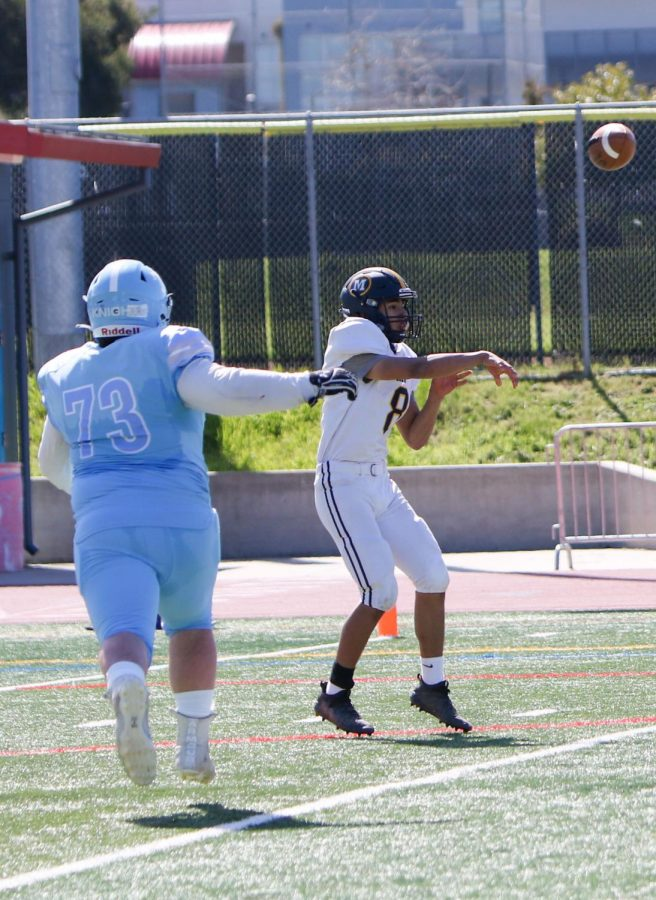 Junior Sergio Beltran completes a throw from the pocket in the season opener against Hillsdale High School. Menlo football recently won their second game against Aragon High School to move to a record of 2-0. Photo courtesy of Pam Tso McKenney.