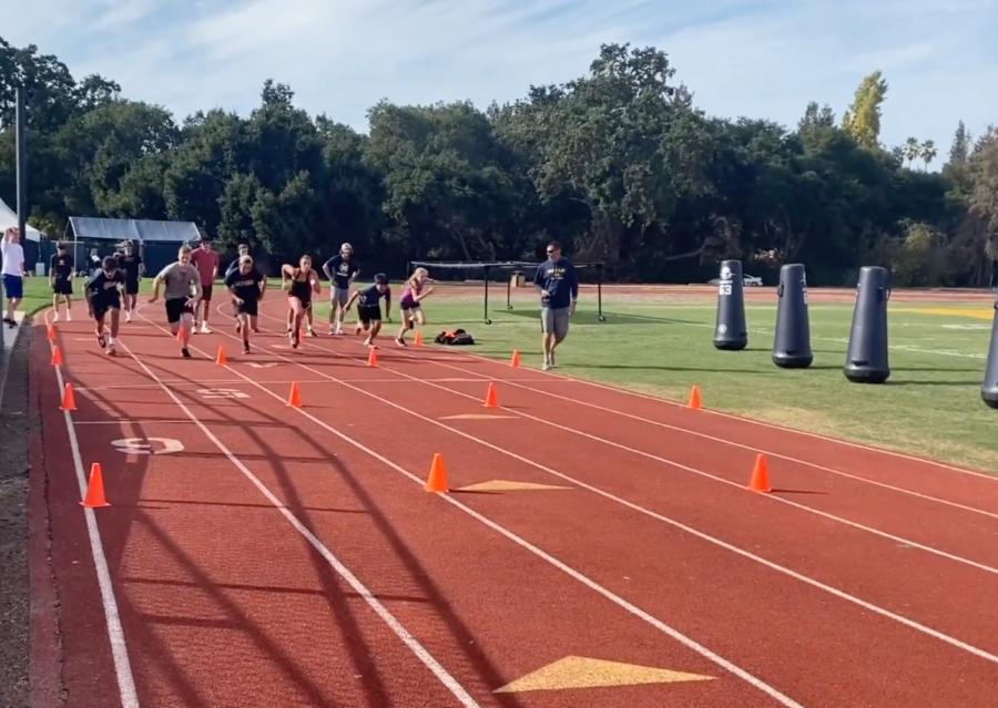 Students from across grades participate in offseason training near Cartan Field. Staff Photo: Alea Marks.